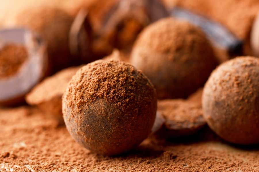 Chocolate bite snack balls dusted with raw cacao powder