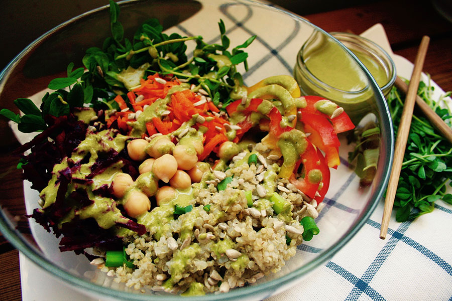vibrant budhha bowl drizzled with green dressing