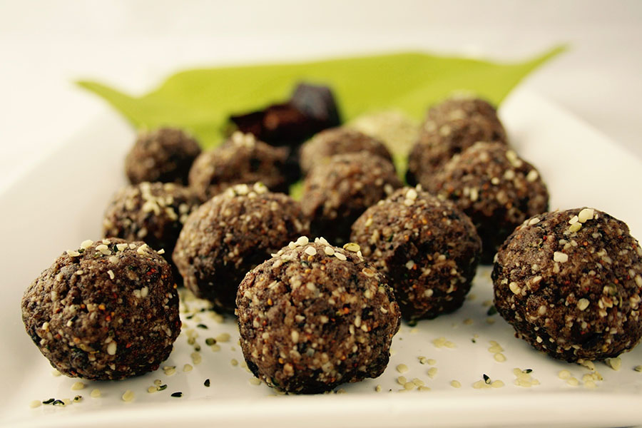 Protein bite balls topped with hemp seeds
